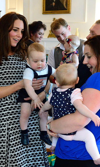 Play date! The Duchess held on to George during a friendly introduction to another little one.