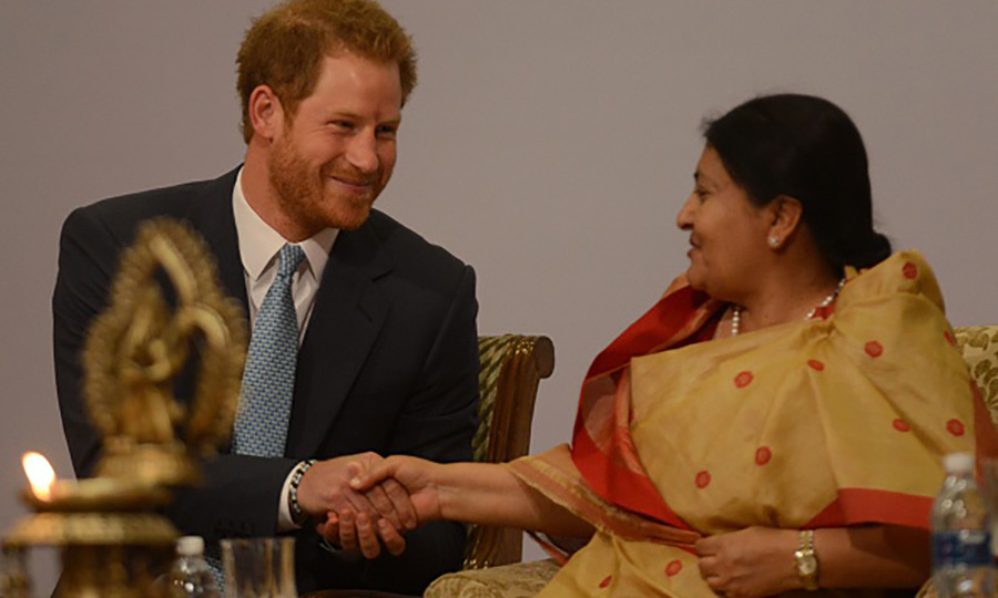 Prince Harry shook hands with Nepalese President Bidhya Devi Bhandari before the start of the 2016 Nepal Girls Summit.