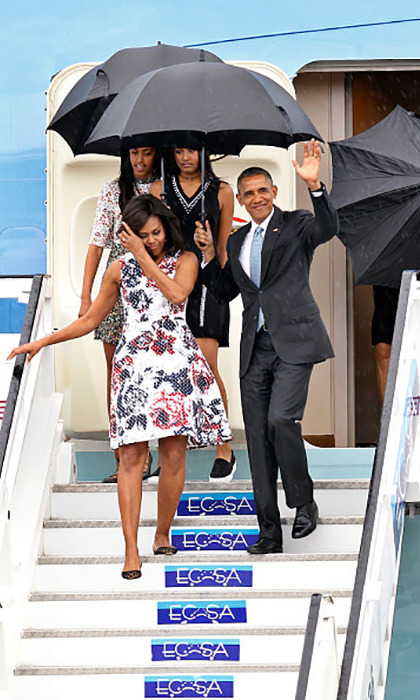March 20: The Obamas touch down in Cuba. President Obama made a statement in a traditional black suit while Michelle wore a Carolina Herrera dress. Not to be outdone by their parents, Sasha made her arrival in a black Shoshanna sheath dress while Malia brought a touch of spring with a floral skater dress from Asos. 