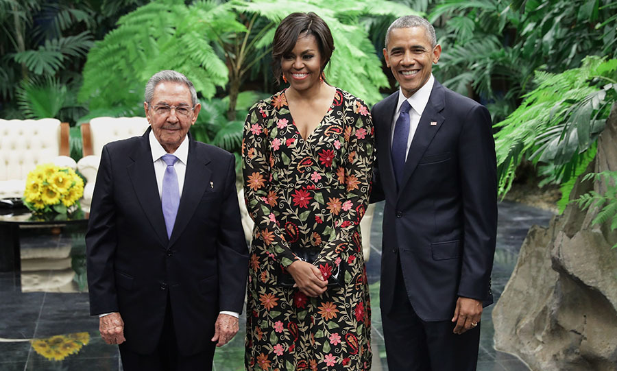 March 21: The couple posed for a photo with Cuban President Raul Castro before the State Dinner. 