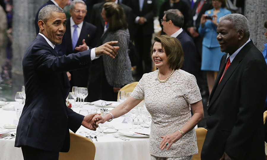 March 21: President Obama greeted Nancy Pelosi during the State Dinner at Palace of the Revolution in Cuba. 