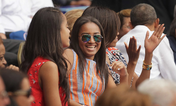 March 22: Sasha and Malia watched the baseball game in style adding a little flair to their attire with sunglasses. 
