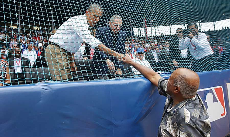 March 22: President Obama greeted baseball legend Luis Tiant after he threw the first pitch at the game.