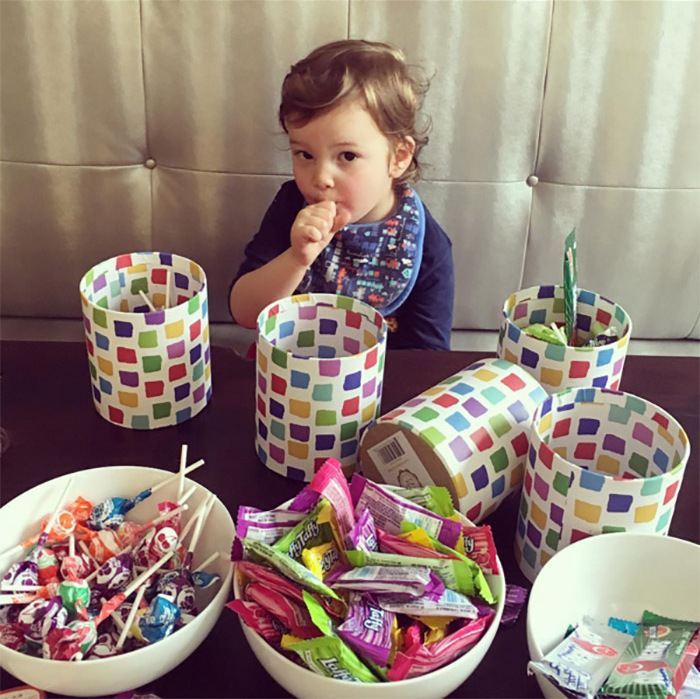 Joseph lent a hand with the treats during the Purim celebration. 