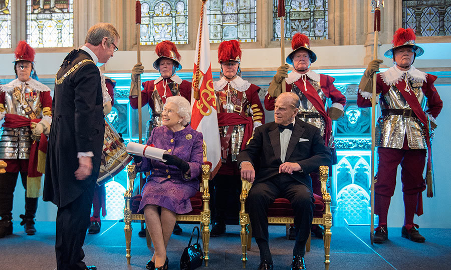 Lord Mayor of the City of London makes a presentation to a delighted Queen Elizabeth during a reception for the High Commissioners' Banquet to mark Commonwealth Week.