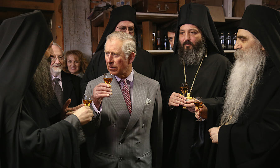 The Prince of Wales was joined by local monks to sample the famous cognac during a visit to Kovilj Monastery in Serbia.