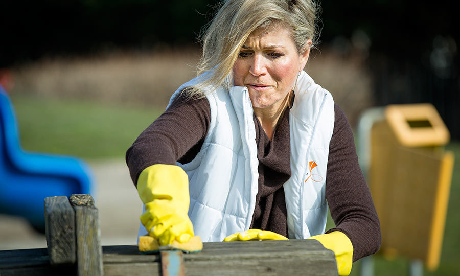 Queen Maxima of The Netherlands wasn't afraid of getting her hands dirty when she helped out the playground and neighborhood association in Vreugdeoord.