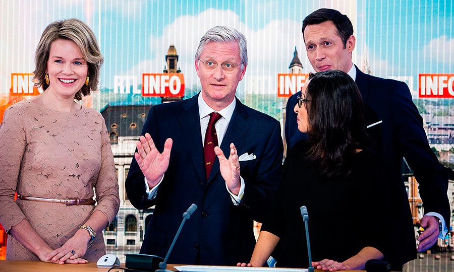 Queen Mathilde and King Philippe of Belgium pose for a photograph during a visit to television station RTL Belgium.