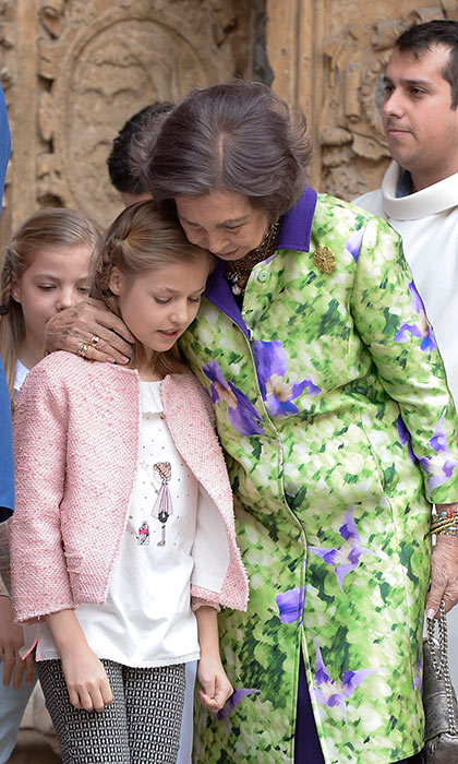 King Felipe of Spain's mother, Queen Sofia, cuddles up to her granddaughter Princess Leonor as the family leave Easter Mass in Palma de Mallorca.