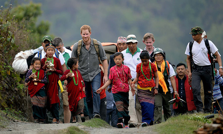 Prince Harry walked with local families and children through the mountain hamlet of Leorani to attend a cultural show by Napelese performers.