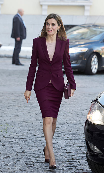 Rocking one of her famous skirt suits, Queen Letizia of Spain highlighted her lean frame in a purple Hugo Boss outfit.