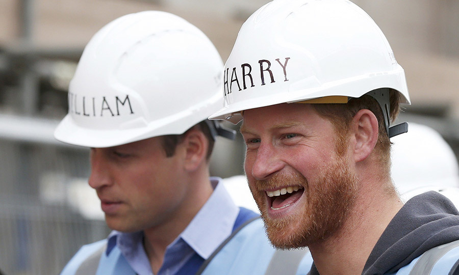 William and Harry showed off their personalized hats during a tour of a building site for the BBC television DIY SOS series in Manchester. 