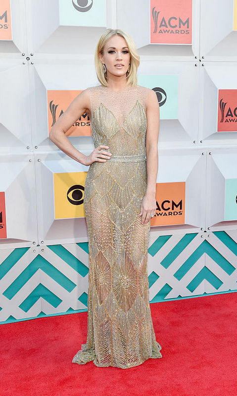 Carrie Underwood in Davidson Zanine gown and Bavna diamond earrings