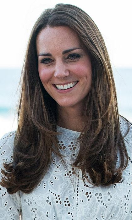 George and Charlotte's mom wore a sleek and straight blow-dry, adding subtle curls at the ends for a touch of bounce.