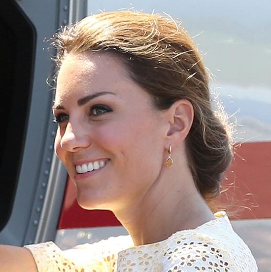 As she and William departed from Honiara, Kate wore her hair swept up loosely and gathered at the nape of her neck.