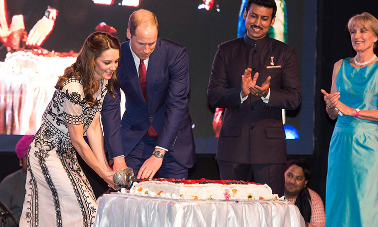 Always time to celebrate! Prince William and Kate Middleton cut cake as they attended a Garden party celebrating the Queen's 90th birthday in New Delhi, India.