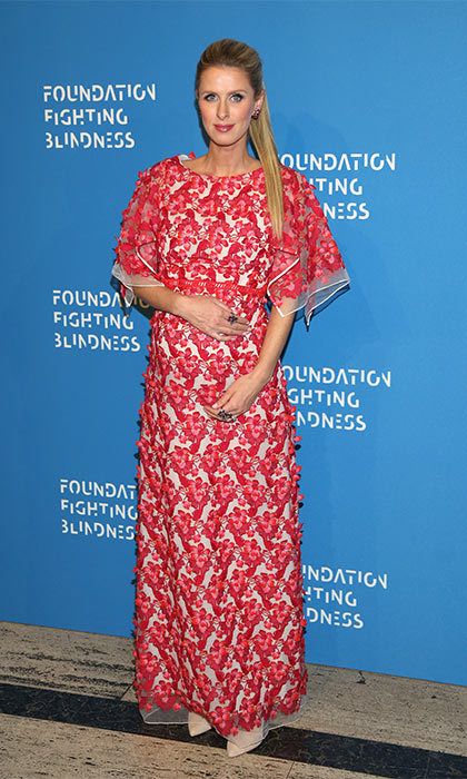 Nicky looked stunning in a red floral dress and Lorraine Schwartz jewellery as she arrived at the Foundation Fighting Blindness world gala in New York City.