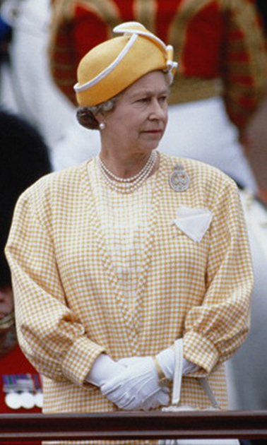 Queen Elizabeth wore a melon-colored hat along with pearls and a Regimental brooch. 