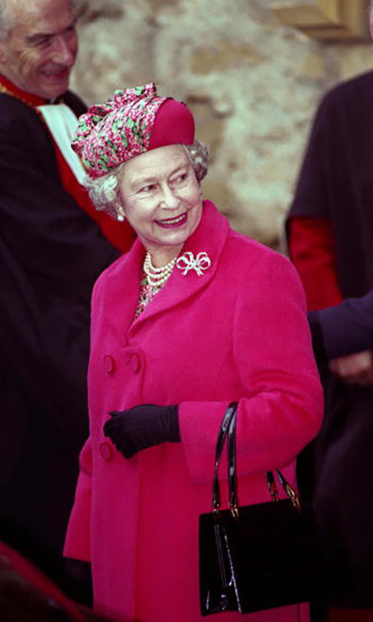 During a trip to the Westminster Abbey after its restoration, the ever-chic Queen matched her pink and green printed hat with her dress and coat.