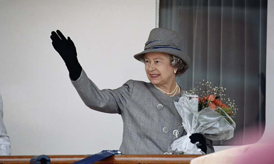 This gray brimmed hat was situated perfectly at a jaunty angle as the monarch waved from aboard the royal yacht <I>Britainnia</I> in Cape Town, South Africa. 