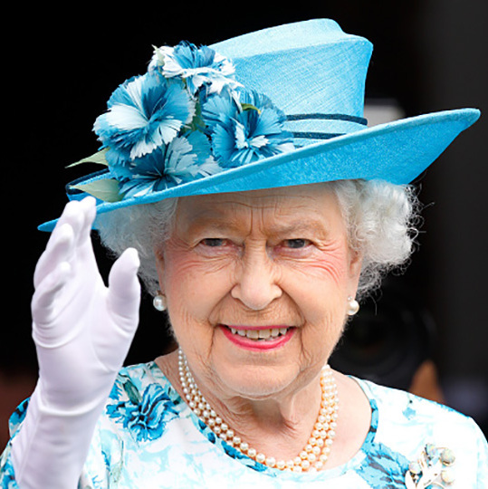 Queen Elizabeth had a blue floral moment while waving from the balcony of the Broadway Theatre during a day of engagements in the London Borough of Barking and Dagenham.