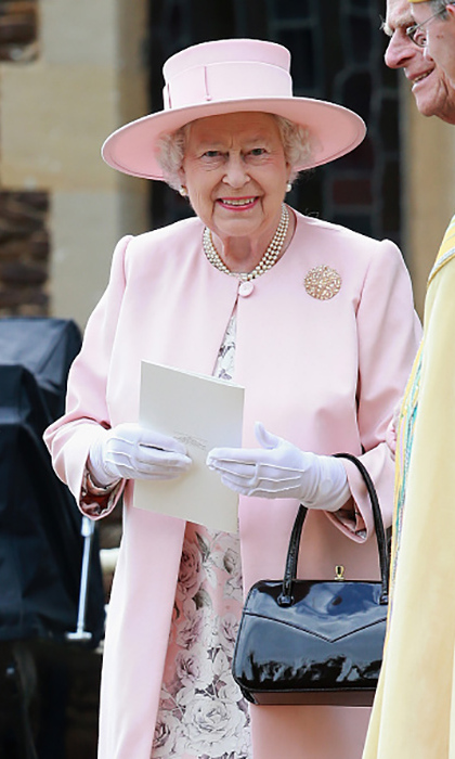 The Queen wore a powder pink hat and jacket for great-granddaughter Princess Charlotte's christening. 