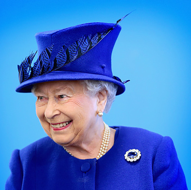 Portrait perfect! The Queen looked regal in a royal blue hat as she greeted people being helped by the Prince's Trust at the Prince's Trust Centre in Kensington.
