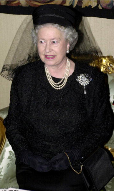 Queen Elizabeth opted for a black lace outfit by Maureen Rose and a pillbox hat with a veil designed by milliner Frederick Fox, during a visit to the Vatican. 