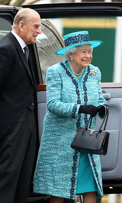 Queen Elizabeth was all smiles – and all fashion–  in a hat that featured trim matching her coat and Prince Philip's tie during the traditional Royal Maundy service at St George's Chapel, Windsor Castle. 