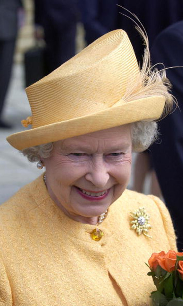 The Queen wore a festive yellow hat during her walkabout at Aker Brygge Quayside in Oslo, Norway.