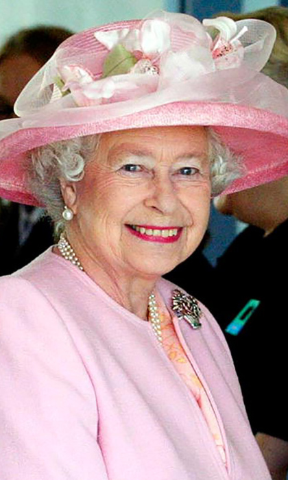 Queen Elizabeth was a pink lady in a darling spring hat during a meeting with the staff at the Dover Ferry terminal in Dover, Kent.