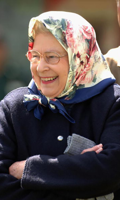 We love this floral scarf so much we're giving it a place on our hat roster! The Queen covered her curls in style while watching the Royal Windsor Horse Show.