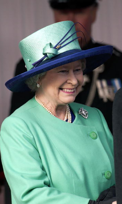 The Queen's hat was turquoise and blue perfection during a trip to Jordan. 
