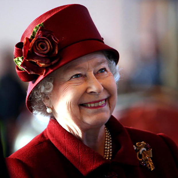 Yes, those are velvet roses – and yes they looked perfect adorning Queen Elizabeth's hat during her visit to the RAF.