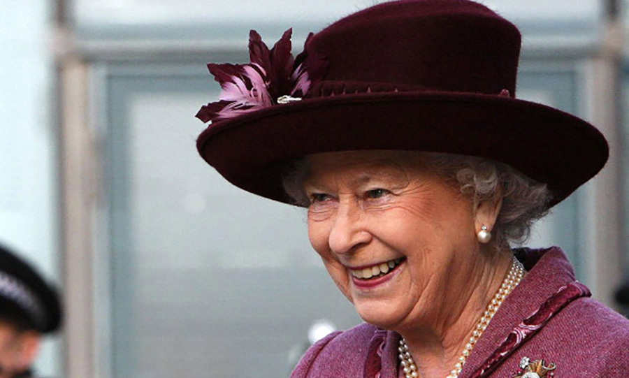 Queen Elizabeth wore a wonderful velvet topper during her visit to the Urbis Center in Manchester, England. 
