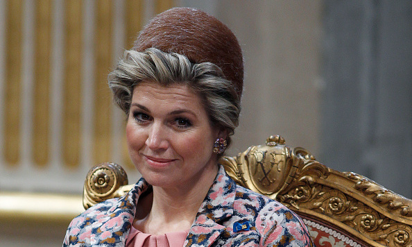 Maxima wore a small round topper during her meeting at City Hall in Paris. 