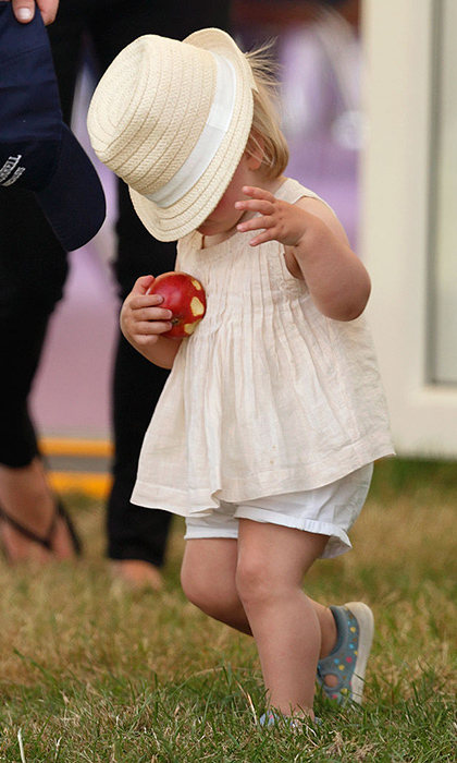 At the same event, the little girl's hat slipped over her eyes, creating this adorable moment captured on camera.
