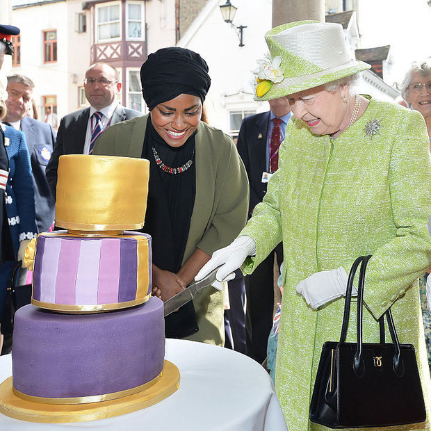 A cake fit for a queen! In celebration of her 90th birthday, Queen Elizabeth cut into an orange drizzle cake with orange curd and buttercream made by <i>Great British Bake Off</i> winner Nadiya Hussain.