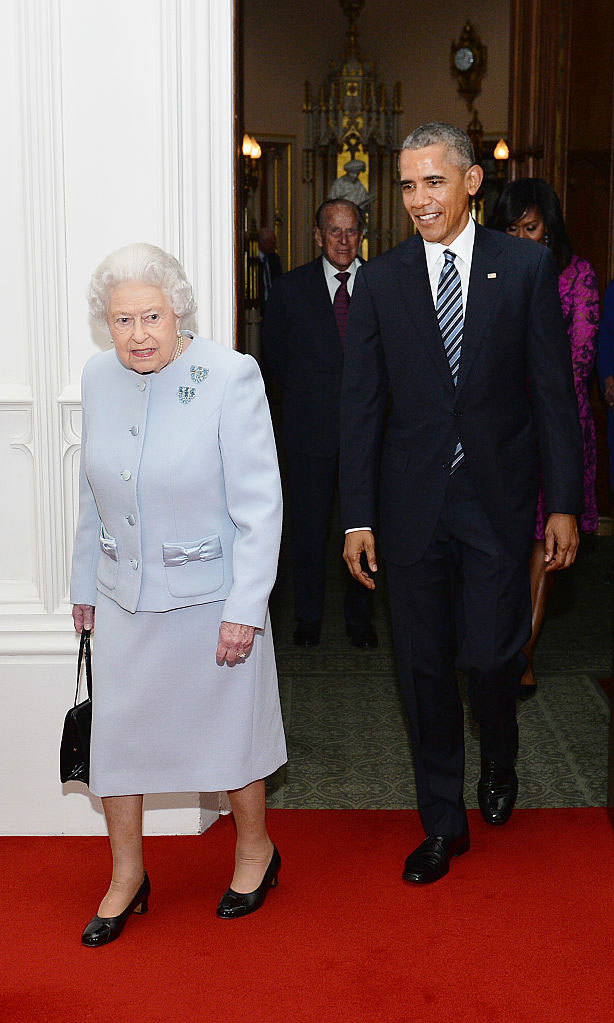 Following the leader! President Obama followed the monarch into the Oak Room of Windsor Castle before enjoying their luncheon.
