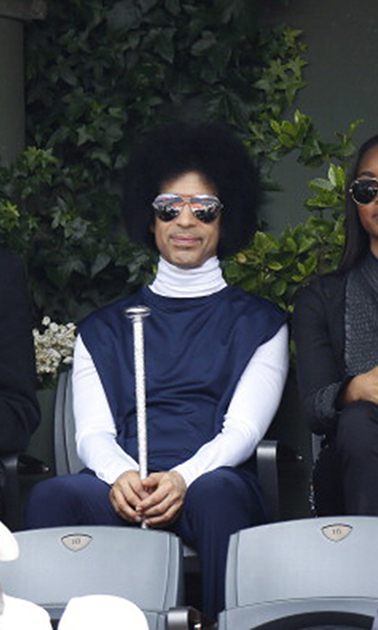 Usually ruling from on stage, Prince held court in the audience at the French Open in 2014.
