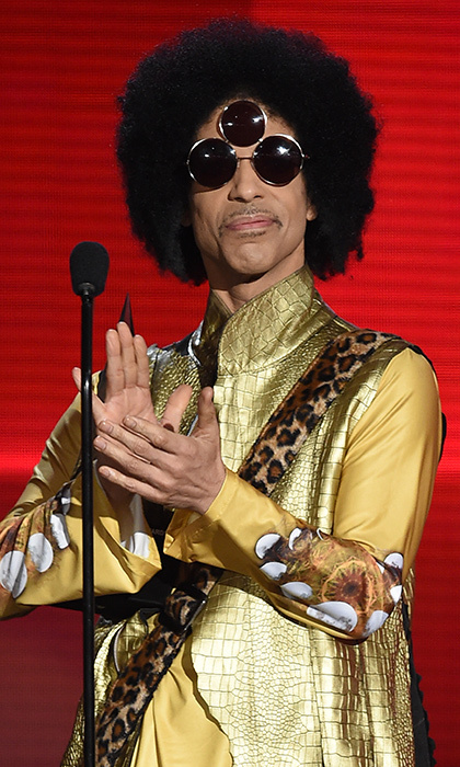 In one of his last major appearances, at the 2015 American Music Awards in November, Prince was as one-of-a-kind as ever, wearing  his 'Third Eye' shades and his guitar over his back.