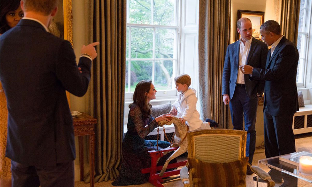 George was the epitome of cuteness wearing his white robe and checkered pajamas to greet his house guests.