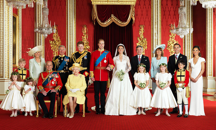 The newlyweds and their wedding party pose for the official portait. Front row, left to right: Grace van Cutsem, Eliza Lopes, Prince Philip Duke of Edinburgh, Queen Elizabeth II, Margarita Armstrong-Jones, Louise Windsor, William Lowther-Pinkerton. Back row, left to right: Tom Pettifer, Camilla Duchess of Cornwall, Prince Charles, Prince Harry, Michael Middleton, Carole Middleton, James Middleton and Pippa Middleton.