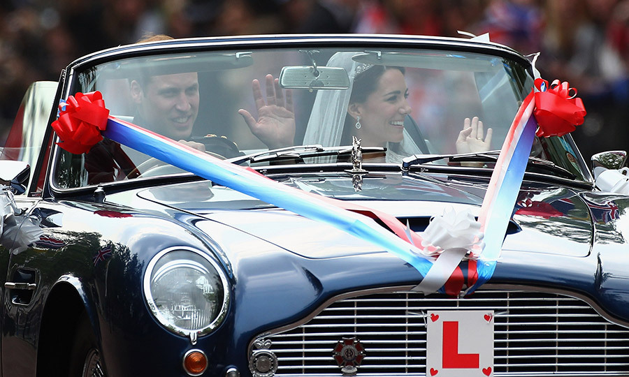 William at the wheel and his new wife by his side.