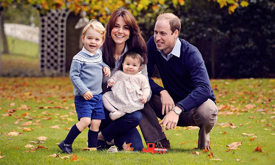 Surrounded by her children and husband Prince William for the Cambridges' first official portait as a family of four.