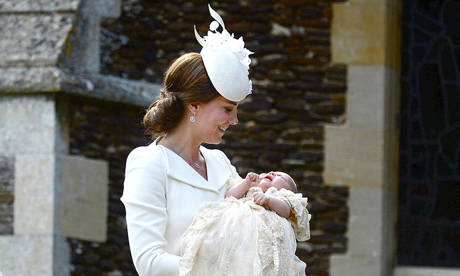 A mother's smile! The Duchess was captured in a moment soothing her little girl. 