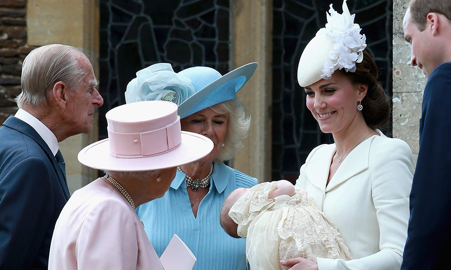 The proud mom cradled Charlotte as she chatted with Queen Elizabeth.