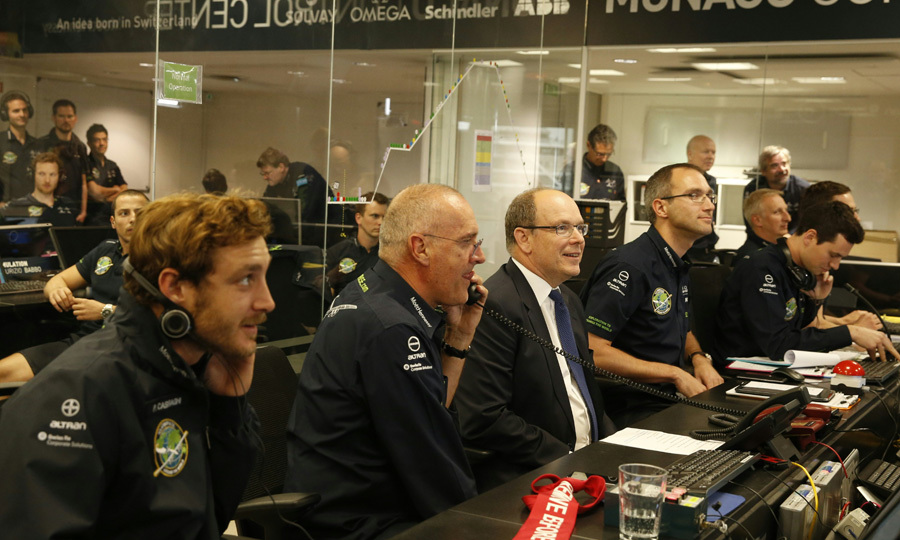 Prince Albert II of Monaco, center, and his nephew Pierre Casiraghi, far left, were invited to sit in the control center of the Solar Impulse 2 solar-powered plane in Monaco. 