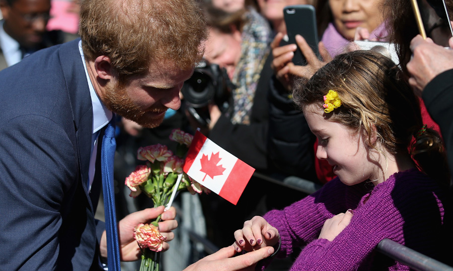 Prince Harry adorably checks out a young girl's manicure during a public meet-and-greet in Toronto.