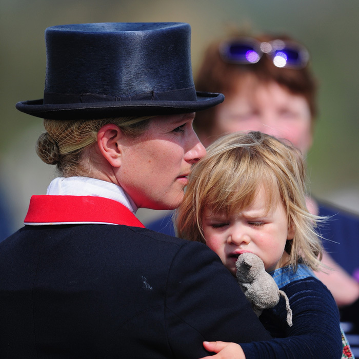 Mia Tindall cuddles up closely to her mom Zara Phillips during a day out at the Badminton Horse trials.